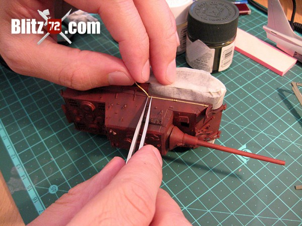 Masking the red oxide shutzen band in Italeri's 1/72 Jagdtiger scale model